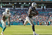 Dez Bryant #88 of the Dallas Cowboys catches a touchdown pass in the end zone past Neville Hewitt #46 of the Miami Dolphins during the second half of the game at Sun Life Stadium on November 22, 2015 in Miami Gardens, Florida.