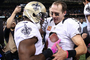 C.J. Spiller #28 hands  Drew Brees #9 of the New Orleans Saints the ball after scoring a touchdown on Brees' 400th Touchdown Pass at Mercedes-Benz Superdome on October 4, 2015 in New Orleans, Louisiana.