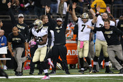 C.J. Spiller #28 of the New Orleans Saints runs for a touchdown to defeat the Dallas Cowboys 26-20 in overtime at Mercedes-Benz Superdome on October 4, 2015 in New Orleans, Louisiana.