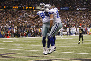 (R-L) Miles Austin #19 of the Dallas Cowboys reacts after his 49-yard touchdown with Kevin Ogletree #85 in the first quarter against the New Orleans Saints at the Louisiana Superdome on December 19, 2009 in New Orleans, Louisiana.