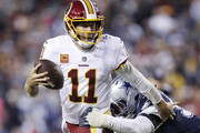 Alex Smith #11 of the Washington Redskins runs the ball in the fourth quarter of the game against the Dallas Cowboys at FedExField on October 21, 2018 in Landover, Maryland. The Redskins won 20-17.