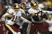 Quarterback Alex Smith #11 of the Washington Redskins scrambles with the ball in the third quarter against the Dallas Cowboys at FedExField on October 21, 2018 in Landover, Maryland.