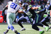 Safety Earl Thomas #29 of the Seattle Seahawks tackles running back Ezekiel Elliott #21 of the Dallas Cowboys in the first half at CenturyLink Field on September 23, 2018 in Seattle, Washington.