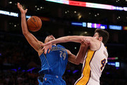 Richard Jefferson #24 of the Dallas Mavericks is fouled by Ryan Kelly #4 of the Los Angeles Lakers at Staples Center on April 12, 2015 in Los Angeles, California.  NOTE TO USER: User expressly acknowledges and agrees that, by downloading and or using this photograph, User is consenting to the terms and conditions of the Getty Images License Agreement.