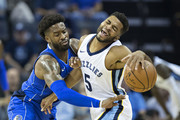 Andrew Harrison #5 of the Memphis Grizzlies is fouled by Wesley Matthews #23 of the Dallas Mavericks at the FedEx Forum on October 26, 2017 in Memphis, Tennessee.  NOTE TO USER: User expressly acknowledges and agrees that, by downloading and or using this photograph, User is consenting to the terms and conditions of the Getty Images License Agreement.