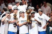 (L-R) Brian Cardinal #35, Finals MVP Dirk Nowitzki #41, Jason Kidd #2, Jason Terry #31 and Shawn Marion #0 of the Dallas Mavericks celebrate with the Larry O'Brien trophy after they won 105-95 against the Miami Heat in Game Six of the 2011 NBA Finals at American Airlines Arena on June 12, 2011 in Miami, Florida. NOTE TO USER: User expressly acknowledges and agrees that, by downloading and/or using this Photograph, user is consenting to the terms and conditions of the Getty Images License Agreement.