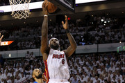 LeBron James #6 of the Miami Heat drives for a shot attempt against Tyson Chandler #6 and Shawn Marion #0 of the Dallas Mavericks in the first half of Game Six of the 2011 NBA Finals at American Airlines Arena on June 12, 2011 in Miami, Florida. NOTE TO USER: User expressly acknowledges and agrees that, by downloading and/or using this Photograph, user is consenting to the terms and conditions of the Getty Images License Agreement.