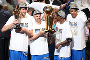 (L-R) Finals MVP Dirk Nowitzki #41, Jason Kidd #2, Jason Terry #31 and Shawn Marion #0 of the Dallas Mavericks celebrate with the Larry O'Brien trophy after they won 105-95 against the Miami Heat in Game Six of the 2011 NBA Finals at American Airlines Arena on June 12, 2011 in Miami, Florida. NOTE TO USER: User expressly acknowledges and agrees that, by downloading and/or using this Photograph, user is consenting to the terms and conditions of the Getty Images License Agreement.
