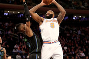 Kyle O'Quinn #9 of the New York Knicks takes a shot against Nerlens Noel #3 of the Dallas Mavericks in the second half during their game at Madison Square Garden on March 13, 2018 in New York City. NOTE TO USER: User expressly acknowledges and agrees that, by downloading and or using this photograph, User is consenting to the terms and conditions of the Getty Images License Agreement.