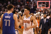 Devin Booker #1 of the Phoenix Suns greets Luka Doncic #77 of the Dallas Mavericks following the NBA game at Talking Stick Resort Arena on October 17, 2018 in Phoenix, Arizona. The Suns defeated defeated the Mavericks 121-100. NOTE TO USER: User expressly acknowledges and agrees that, by downloading and or using this photograph, User is consenting to the terms and conditions of the Getty Images License Agreement.