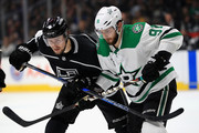 Adrian Kempe #9 of the Los Angeles Kings and Tyler Seguin #91 of the Dallas Stars battle for postition during the second  period of a game  at Staples Center on April 7, 2018 in Los Angeles, California.