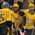 Craig Smith Photos - Pekka Rinne #35 and Dan Hamhuis #5 of the Nashville Predators congratulate teammate Craig Smith #15 after scoring the game winning goal of 2-1 Predators victory over the Dallas Starsin Game Two of the Western Conference First Round during the 2019 NHL Stanley Cup Playoffs at Bridgestone Arena on April 13, 2019 in Nashville, Tennessee. - Dallas Stars vs. Nashville Predators - Game Two