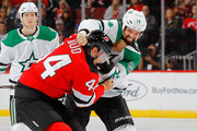 Jamie Benn #14 of the Dallas Stars squares off against Miles Wood #44 of the New Jersey Devils during the third period on October 16, 2018 at Prudential Center in Newark, New Jersey.