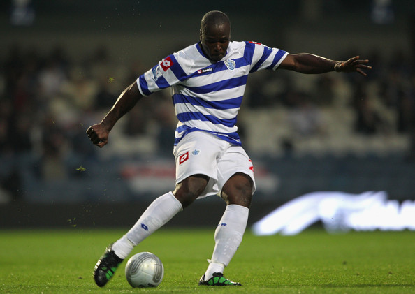 Danny Shittu Danny Shittu of Queens Park Rangers with the ball during the Carling Cup second round match between Queens Park Rangers and Rochdale at Loftus Road on August 23, 2011 in London, England.