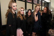 Designer Dara Senders (C), Edward Tricomi (R) and models pose backstage during the Dara Senders New York City Launch Presentation and Cocktail event on November 7, 2018 in New York City.