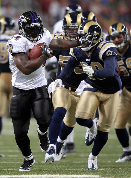 The Rams defense gives chase to Ray Rice. Jamie Squire/Getty Images