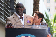 Chris Gardner (L) and Dave Koz speak during the ceremony honoring Koz with a star on the Hollywood Walk of Fame on September 22, 2009 in Los Angeles, California.