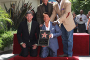 (L-R) Leron Gubler, recording artist Dave Koz, Barry Manilow and Chris Gardner pose for photographers during ceremony honoring Koz with a star on the Hollywood Walk of Fame on September 22, 2009 in Los Angeles, California.