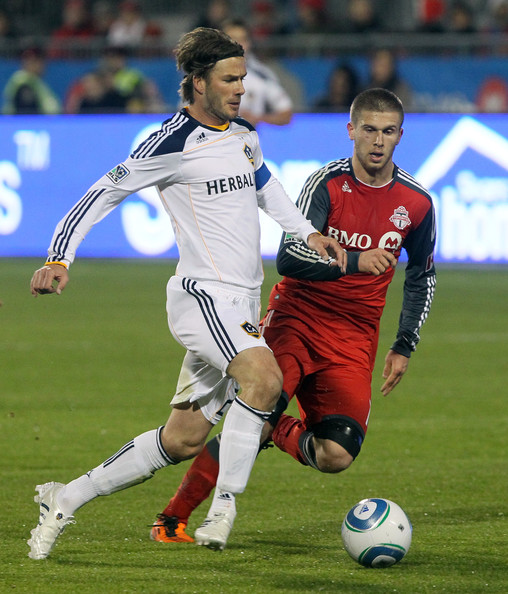 David Beckham Alen Stevanovic #10 of Toronto FC heads off David Beckham #23 of Los Angeles Galaxy during MLS action at BMO Field April 13, 2011 in Toronto, Ontario, Canada.