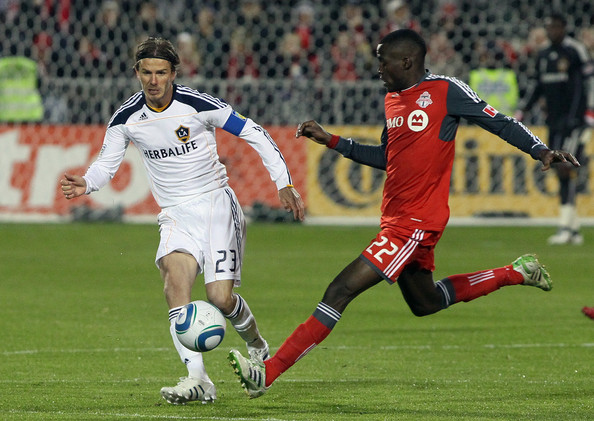 David Beckham Tony Tchani #22 of Toronto FC tries to catch David Beckham #23 of Los Angeles Galaxy during MLS action at BMO Field April 13, 2011 in Toronto, Ontario, Canada.