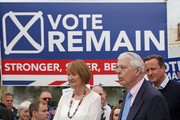 """British Prime Minister David Cameron (R) stands with Labour MP Harriet Harman (L) as former Conservative Prime Minister Sir John Major addresses pro-EU """"Vote Remain"""" supporters during a rally on June 22, 2016 in Bristol, United Kingdom. The final day of campaigning continues across the UK as the country prepares to go to the polls on June 23rd to decide whether Britain should remain or leave the European Union."""