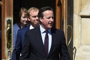 Britain's Prime Minister David Cameron arrives with Liberal Democrat Leader Tim Farron and Labour MP Harriet Harman at a Remain in the EU campaign event at the Oval cricket ground on June 6, 2016 in London, England.