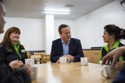 British Prime Minister David Cameron (C) speaks to Asda employees during a visit to an Asda supermarket in Hayes on May 22, 2016 in London, England. Mr Cameron and politicians from different political parties are campaigning to remain in the European Union ahead of the EU referendum on June 23.