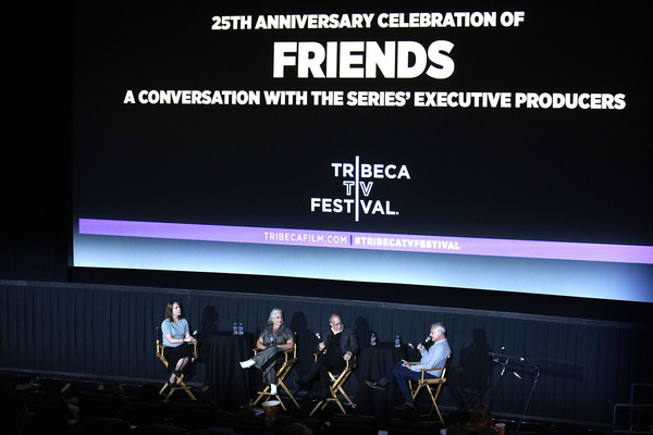 'Friends' 25th Anniversary - 2019 Tribeca TV Festival [display device,stage,technology,font,electronic device,performance,event,advertising,talent show,flat panel display,executive producers,kevin bright,david crane,marta kauffman,l-r,regal battery park cinemas,new york city,friends 25th anniversary,tribeca tv festival]