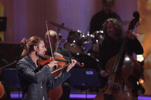 'Die Schoensten Weihnachtshits Mit Carmen Nebel' Show [show,attends,music,string instrument,musician,performance,violin,entertainment,violinist,bowed string instrument,violist,musical instrument,carmen nebel,david garrett,schoensten,germany,december 6,munich,weihnachtshits]