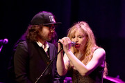 """(L-R) Musicians Kevin Drew and Courtney Love perform onstage during The David Lynch Foundation's DLF Live Celebration of the 60th Anniversary of Allen Ginsberg's """"HOWL"""" with Music, Words, and Funny People at The Theatre at Ace Hotel on April 7, 2015 in Los Angeles, California."""