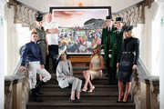 Royal Ascot Greencoats, models, Michelin Starred chef Tom Kerridge (3rd L), jockey Johnny Murtagh (L), fashion designer  Amanda Wakeley (R) and milliner Jane Taylor (2nd L) pose with a collage by David Mach entitled The Great British Drama, depicting a scene at Royal Ascot, at the Royal Academy of Arts on February 11, 2014 in London, England. The artwork, which was commissioned to celebrate Royal Ascot 2014, is made up of more than 200 images from the historic race meeting, bringing to life many of its remarkable stories. Royal Academist David Machs collage features images of several Royal Ascot winning horses and thousands of racegoers celebrating alongside Michelin Starred chefs, Greencoats, TV presenters and trainers.