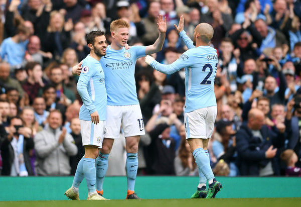 Manchester City v Swansea City - Premier League [player,sports,team sport,ball game,sport venue,football player,soccer player,product,championship,social group,kevin de bruyne,bernardo silva,david silva,v,goal,side,manchester city,swansea city,premier league,match]