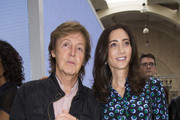 Sir Paul McCartney and Nancy Shevell attends the Hunter Original show during London Fashion Week Spring Summer 2015 at  on September 13, 2014 in London, England.
