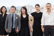 """Kim Sae-byeok, Cho Yun-hee, Kwon Hae-hyo, Kim Min-hee and director Hong Sangsoo attends """"The Day After (Geu Hu)"""" photocall during the 70th annual Cannes Film Festival at Palais des Festivals on May 22, 2017 in Cannes, France."""