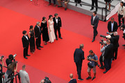 """(R-L) Actors Haehyo Kwon, Cho Yunhee and Kim Minhee, director Hong SangSoo attend """"The Day After (Geu Hu)"""" premiere during the 70th annual Cannes Film Festival at Palais des Festivals on May 22, 2017 in Cannes, France."""