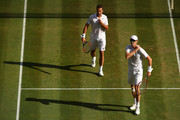 Jamie Murray of Great Britain and Bruno Soares of Brazil compete against Raven Klaasen of South Africa and Michael Venus of New Zealand during their Men's Doubles Quarter-Finals match on day eight of the Wimbledon Lawn Tennis Championships at All England Lawn Tennis and Croquet Club on July 10, 2018 in London, England.