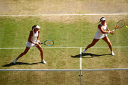 Timea Babos of Hungary, playing partner of Kristina Mladenovic of France plays a backhand in their Ladies' Doubles semi-final match against Su-Wei Hsieh of Taiwan and Barbora Strycova of The Czech Republic during Day eleven of The Championships - Wimbledon 2019 at All England Lawn Tennis and Croquet Club on July 12, 2019 in London, England.