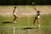 Kristina Mladenovic of France, playing partner of Timea Babos of Hungary serves in their Ladies' Doubles semi-final match against Su-Wei Hsieh of Taiwan and Barbora Strycova of The Czech Republic during Day eleven of The Championships - Wimbledon 2019 at All England Lawn Tennis and Croquet Club on July 12, 2019 in London, England.