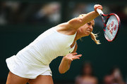 Sabine Lisicki of Germany serves against Christina McHale of USA in her Women's Singles Second Round match during day four of the Wimbledon Lawn Tennis Championships at the All England Lawn Tennis and Croquet Club on July 2, 2015 in London, England.