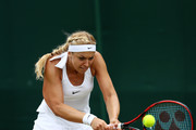 Sabine Lisicki of Germany plays a back hand during the Ladies Singles second round match agaist Samantha Stosur of Australia on day four of the Wimbledon Lawn Tennis Championships at the All England Lawn Tennis and Croquet Club on June 30, 2016 in London, England.