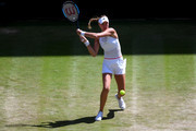 Kristina Mladenovic of France plays a backhand in her Ladies' Singles second round match against Petra Kvitova of The Czech Republic  during Day four of The Championships - Wimbledon 2019 at All England Lawn Tennis and Croquet Club on July 04, 2019 in London, England.