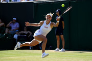Angelique Kerber of Germany plays a forehand in her Ladies' Singles second round match against Lauren Davis of The United States during Day four of The Championships - Wimbledon 2019 at All England Lawn Tennis and Croquet Club on July 04, 2019 in London, England.