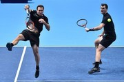 Britain's Jamie Murray (R) and Brazil's Bruno Soares play against Croatia's Ivan Dodig and Bosnia-Herzegovina's Marcel Granollers during their men's doubles round-robin match on day four of the ATP World Tour Finals tennis tournament at the O2 Arena in London on November 15, 2017. / AFP PHOTO / Glyn KIRK