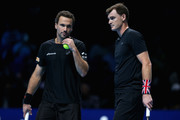 Bruno Soares of Brazil and partner Jamie Murray of Great Britain chat during the doubles match against Ivan Dodig of Croatia and Marcel Granollers of Spain on day four of the 2017 Nitto ATP World Tour Finals at O2 Arena on November 15, 2017 in London, England.
