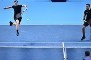 Britain's Jamie Murray (L) and Brazil's Bruno Soares play against Croatia's Ivan Dodig and Bosnia-Herzegovina's Marcel Granollers during their men's doubles round-robin match on day four of the ATP World Tour Finals tennis tournament at the O2 Arena in London on November 15, 2017. / AFP PHOTO / Glyn KIRK