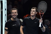 Britain's Jamie Murray (R) and Brazil's Bruno Soares react after winning against Croatia's Ivan Dodig and Bosnia-Herzegovina's Marcel Granollers during their men's doubles round-robin match on day four of the ATP World Tour Finals tennis tournament at the O2 Arena in London on November 15, 2017..Murray and Soares won 6-1, 6-1. / AFP PHOTO / Glyn KIRK