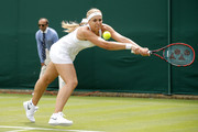 Sabine Lisicki of Germany plays a back hand shot during the Ladies Singles first round match against Shelby Rogers of The United States on day one of the Wimbledon Lawn Tennis Championships at the All England Lawn Tennis and Croquet Club on June 27th, 2016 in London, England.