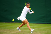 Francesca Schiavone of Italy plays a backhand during the Ladies Singles first round match against Mandy Minella of Luxembourg on day one of the Wimbledon Lawn Tennis Championships at the All England Lawn Tennis and Croquet Club on July 3, 2017 in London, England.