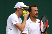 Jamie Murray of Great Britain and Bruno Soares of Brazil talk tactics against Ken Skupski and Neal Skupski of Great Britain during their Men's Doubles third round match on day seven of the Wimbledon Lawn Tennis Championships at All England Lawn Tennis and Croquet Club on July 9, 2018 in London, England.