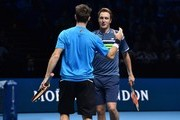 Australia's John Peers (L) celebrates winning matchpoint with his partner Finland's Henri Kontinen (R) after their men's doubles semi-final match against Britain's Jamie Murray and Brazil's Bruno Soares on day seven of the ATP World Tour Finals tennis tournament at the O2 Arena in London on November 18, 2017. / AFP PHOTO / Glyn KIRK